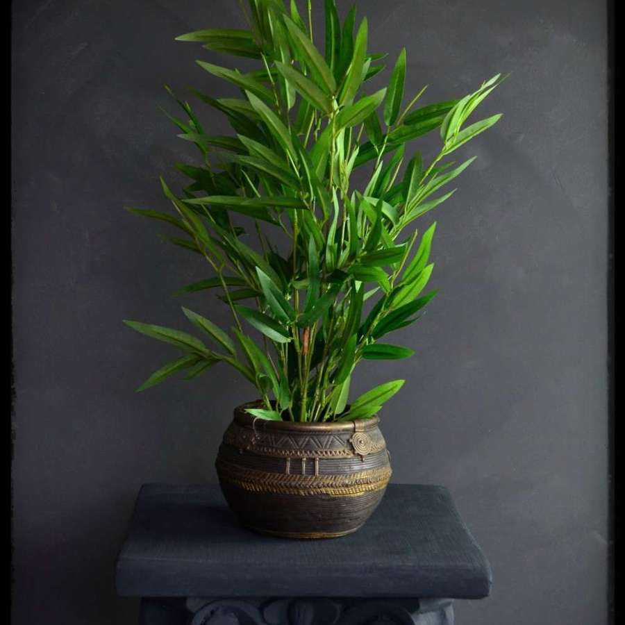 'Eternal' faux bamboo plant in a black plastic pot